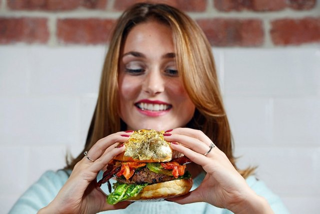 """A restaurant in Chelsea is giving customers the ultimate post-pub treat – by selling a burger for £1,100. The world's most expensive burger, dubbed the """"Glamburger"""", is stuffed with a burger patty made from 220 grams of Kobe Wagyu beef minced with 60 grams of New Zealand venison and seasoned with smoked Himalayan salt. (Photo by Groupon)"""