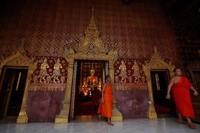 Monks attend an evening prayer at Wat Sene Buddhist temple in Luang Prabang, Laos July 30, 2016. (Photo by Jorge Silva/Reuters)