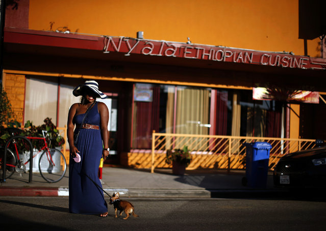 A woman poses for a friend's photo in the Little Ethiopia area of Los Angeles, California September 14, 2014. (Photo by Lucy Nicholson/Reuters)