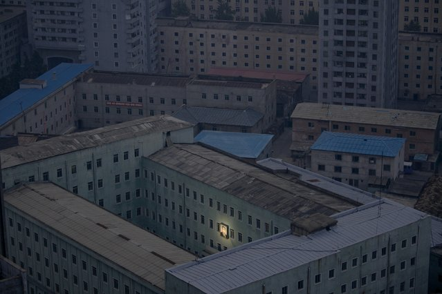 A picture of North Korea's founder Kim Il-sung on a building in Pyongyang, North Korea on February 13, 2015. (Photo by Damir Sagolj/Reuters)