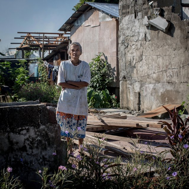 Typhoon Haiyan survivor Fermina Durana Reguiez stands amongst the ruins of her home on November 7, 2014 in Palo, Leyte, Philippines. Fermina survived the typhoon and storm surge in her house and has not rebuilt yet due to being hospitalized for three months after the typhoon and is now having problems with paperwork for her property. (Photo by Chris McGrath/Getty Images)