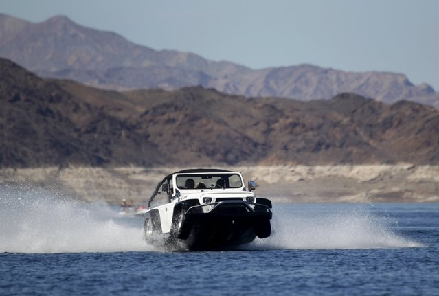A Panther WaterCar is shown during the first Las Vegas Amphicar Swim-in at Lake Mead near Las Vegas, Nevada October 9, 2015. The Panther can reach speeds of 44 mph (70.8 km/h) on the water, according to the company's website. (Photo by Steve Marcus/Reuters)