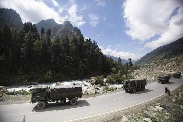 """An Indian army convoy moves on the Srinagar- Ladakh highway at Gagangeer, northeast of Srinagar, Indian-controlled Kashmir, Tuesday, September 1, 2020. India said Monday its soldiers thwarted """"provocative"""" movements by China's military near a disputed border in the Ladakh region months into the rival nations' deadliest standoff in decades. China's military said it was taking """"necessary actions in response"""", without giving details. (Photo by Mukhtar Khan/AP Photo)"""