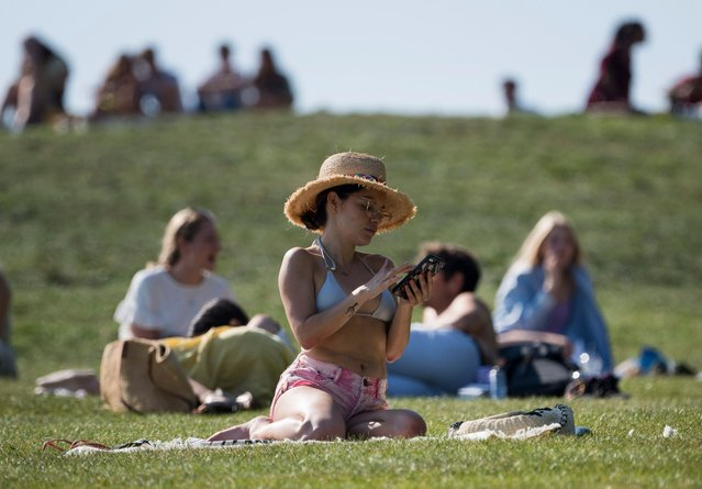"""People enjoying the Autumn sunshine on Primrose Hill, London on September 14, 2020. The public has been urged to act """"in tune"""" with Covid-19 guidelines the """"rule of six"""" restrictions. (Photo by London News Pictures/The Sun)"""