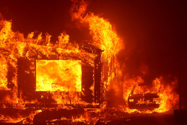Mobile homes burn at the Spanish Flat Mobile Villa as the LNU Lightning Complex Fire burns through the area on August 18, 2020 in Napa, California. The LNU Lightning Complex Fire continues to burn near Lake Berryessa near the town of Napa. The fire is zero percent contained. (Photo by Justin Sullivan/Getty Images)