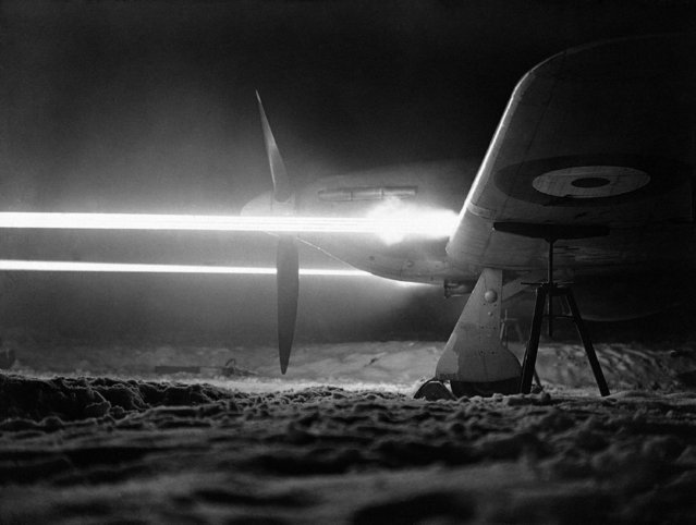 Remarkable picture of the guns of a Hurricane aircraft of Fighter Command Royal Air Force firing a burst of 1600 rounds at night. To secure the luminous effect a proportion of one tracer bullet in four rounds was introduced. The effect recorded by a camera placed on the ground on the port side of the Hurricane, at an airfield in England, on February 15, 1942. (Photo by AP Photo)