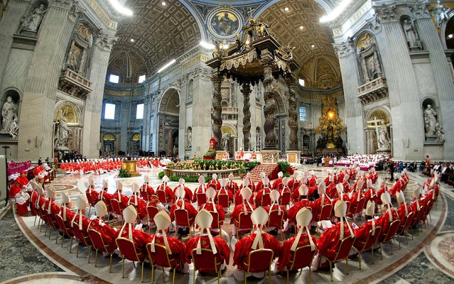 The cardinals attend a Mass for the election of a new pope celebrated by Cardinal Angelo Sodano inside St. Peter's Basilica, March 12, 2013. (Photo by L'Osservatore Romano)