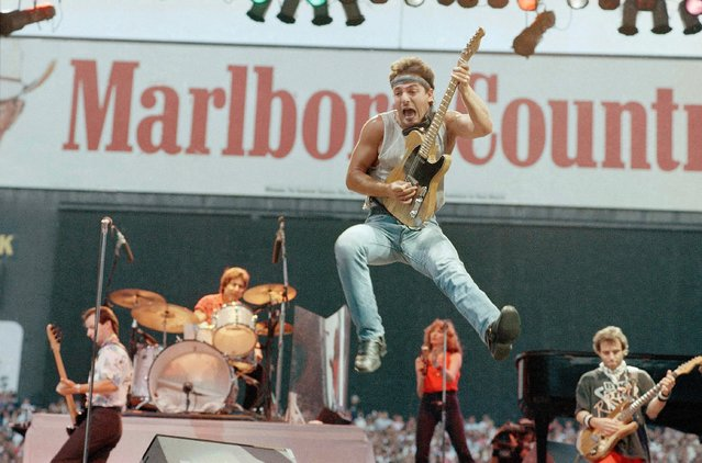 Bruce Springsteen leaps into the air during a concert in front of 71,000 screaming fans at Cleveland Stadium, August 7,1985. Springsteen and his E-Street band are on a tour of North America. (Photo by Mark Duncan/AP Photo)