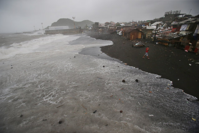 Strong waves caused by Typhoon Hagupit  approach a coastal village in Legazpi, Albay province, eastern Philippines on Sunday, December 7, 2014. (Photo by Aaron Favila/AP Photo)