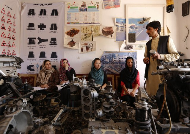 An instructor (R) teaches women about a car's mechanics during a technical lesson at a driving school in Kabul August 11, 2014. (Photo by Mohammad Ismail/Reuters)