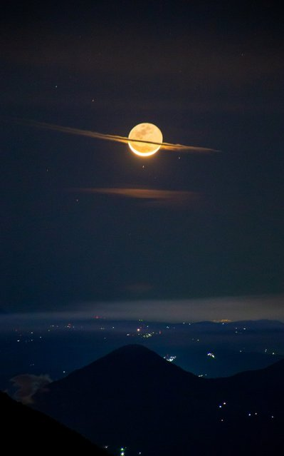An incredible image of the Moon looking like Saturn has been captured by a lucky photographer in Guatemala on March 2020. From the perspective of the Acatenango volcano base camp rings of clouds disguised our closest neighbour as the famous ringed planet. The majestic shot was captured by photographer Francisco Sojue. The snap was taken just before sunrise. It shows the Moon with clouds perfectly positioned in the form of rings. (Photo by Francisco Sojue/South West News Service)