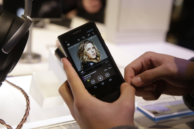 An attendee holds Sony's new Walkman at the Sony booth at the International CES Monday, January 5, 2015, in Las Vegas. (Photo by Jae C. Hong/AP Photo)