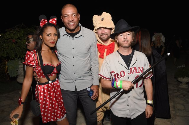 Basketball coach Doc Rivers and comedian David Spade and guests attend the Casamigos Halloween Party at a private residence on October 28, 2016 in Beverly Hills, California. (Photo by Michael Kovac/Getty Images for Casamigos Tequila)