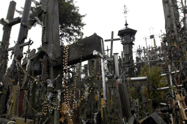 Rosary beads hang from a cross on Lithuania's Hill of Crosses. (Photo by Richard Gardner/Rex USA)