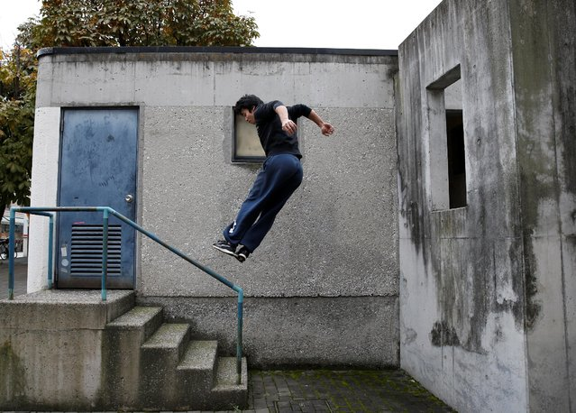 Jun Sato, founder of Japan's first parkour educational institute SENDAI X-TRAIN, demonstrates his parkour skill  at a park in Tokyo, Japan November 2, 2016. (Photo by Kim Kyung-Hoon/Reuters)