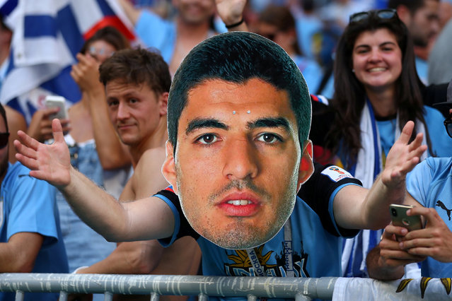 Uruguay fan wearing a cardboard cut out mask of Luis Suarez inside the stadium before the Russia 2018 World Cup Group A football match between Uruguay and Russia at the Samara Arena in Samara on June 25, 2018. (Photo by Pilar Olivares/Reuters)