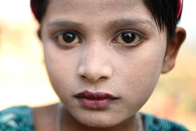 Sufaida, a Rohingya refugee aged seven and wearing traditional thanaka paste, poses for a photograph at the Kutupalong refugee camp in Cox's Bazaar, Bangladesh, March 30, 2018. (Photo by Clodagh Kilcoyne/Reuters)