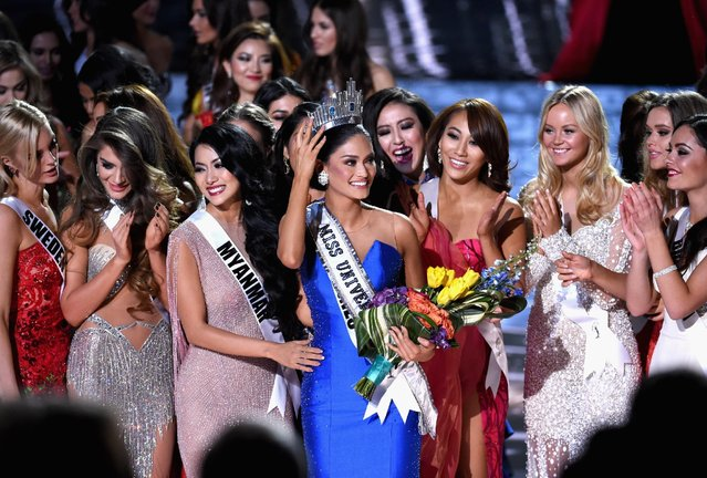 Miss Philippines 2015, Pia Alonzo Wurtzbach (C), who was mistakenly named as First Runner-up reacts with other contestants after being named the 2015 Miss Universe during the 2015 Miss Universe Pageant at The Axis at Planet Hollywood Resort & Casino on December 20, 2015 in Las Vegas, Nevada. (Photo by Ethan Miller/Getty Images)