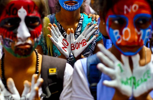 Students with their faces painted in colors, participate in a Hiroshima Day peace rally in Mumbai, India, on August 6, 2013. Tuesday marked the 68th anniversary of the world's first atomic bombing that killed as many as 140,000 people. (Photo by Rafiq Maqbool/Associated Press)