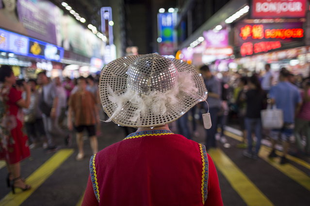 A busker performing in Sai Yeung Choi Street South in Mongkok district, Hong Kong, China, 29 July 2018. (Photo by Jerome Favre/EPA/EFE)