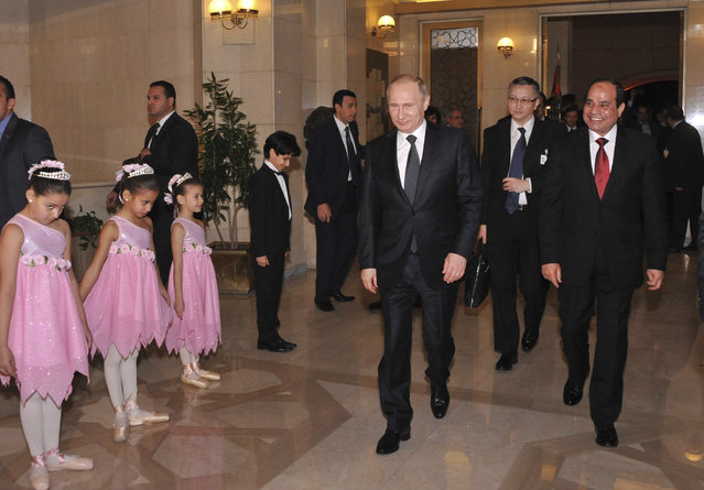 Egypt's President Abdel Fattah al-Sisi (R) walks with Russia's President Vladimir Putin (C) as they arrive at the opera house during Putin's visit in Cairo February 9, 2015. (Photo by Reuters/The Egyptian Presidency)