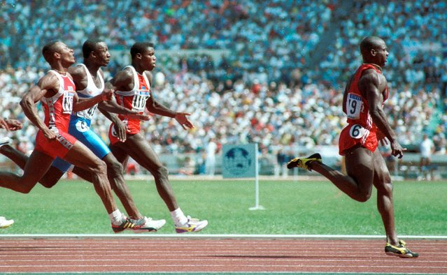 Sprinter Ben Johnson wins the gold medal in the 100m sprint at the Seoul Olympics in this September 24, 1988 file photo. Behind him are (L to R) Calvin Smith, Linford Christie and Carl Lewis. Johnson later lost the medal when he tested positive for steroids. (Photo by Gary Hershorn/Reuters)