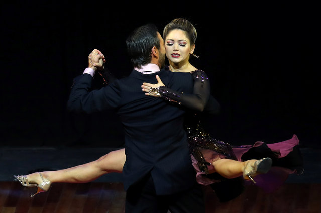 Hernan Raigosa and Yaisuri Salamanca, representing the city of Cali, Colombia, perform during the Stage style final round at the Tango World Championship in Buenos Aires, Argentina on August 23, 2018. (Photo by Marcos Brindicci/Reuters)