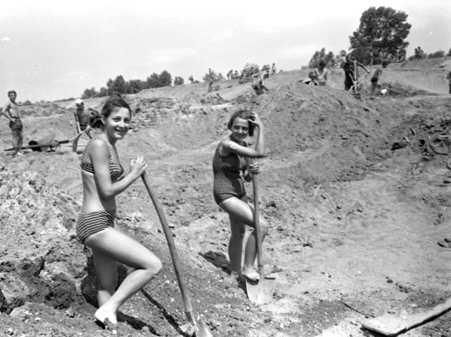 Boys and girls taking part in a Communist Youth labour camp in former Yugoslavia, 1963. They were working on a river project. (Photo by David Lewis Hodgson/Mary Evans Picture Library)