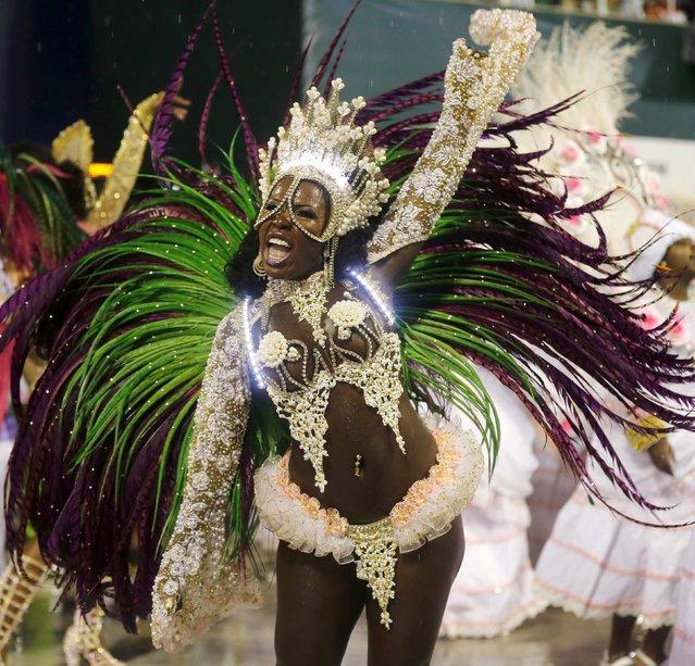 A reveller from the Mangueira samba school participates in the annual carnival parade in Rio de Janeiro's Sambadrome, February 15, 2015. (Photo by Sergio Moraes/Reuters)
