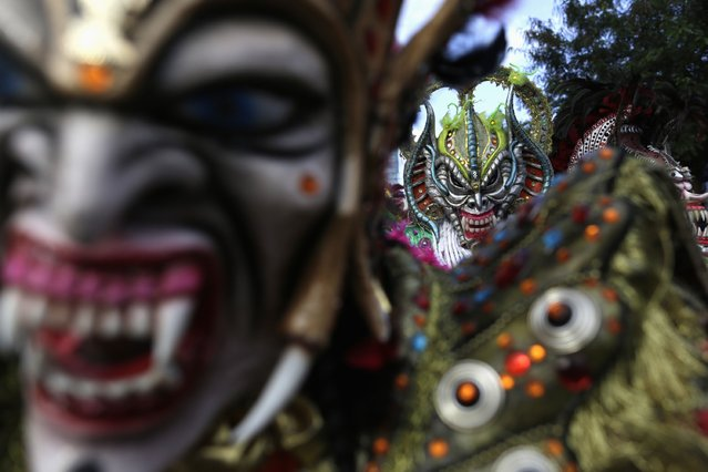 Revelers wearing masks participate in the third day of the annual Carnival parade in Panama City February 16, 2015. (Photo by Carlos Jasso/Reuters)