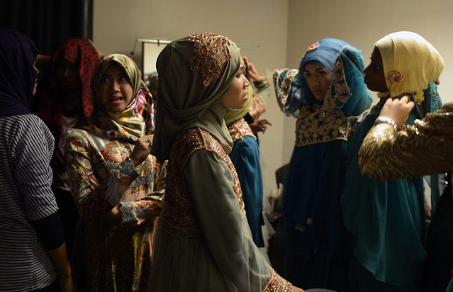 Contestants of the Muslimah World pageant prepare for the grand final of the contest in Jakarta on September 18, 2013. (Photo by Adek Berry/AFP Photo)