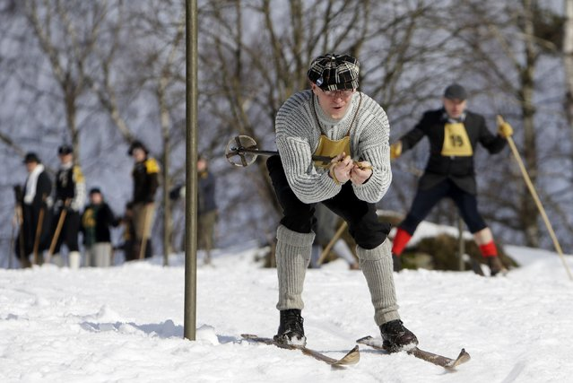 Participants compete on vintage skis during a traditional historical ski race in the northern Bohemian town of Smrzovka February 21, 2015. (Photo by David W. Cerny/Reuters)