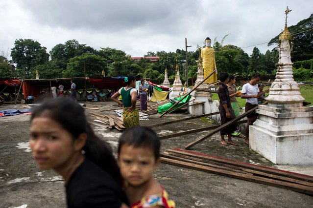 Flood victims take shelter at a temple compound in Taungnu township of Bago region in Myanmar on August 31, 2018. (Photo by Ye Aung Thu/AFP Photo)