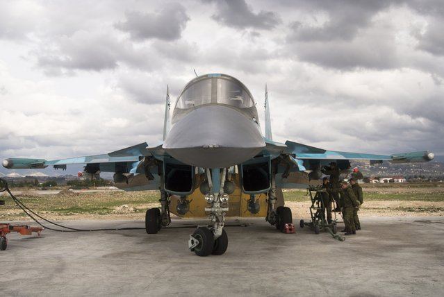 Russian air force crew prepare a bomber for a combat mission at Hemeimeem air base in Syria on Wednesday January 20, 2016. (Photo by Vladimir Isachenkov/AP Photo)