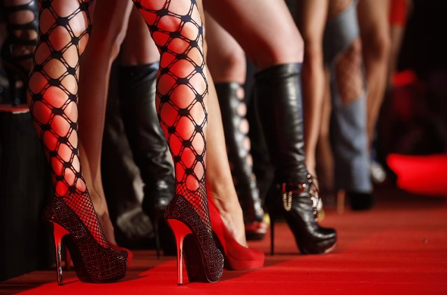 """p*rn actresses line-up at the opening of the """"Venus"""" erotic fair in Berlin October 17, 2013. The event, which represents the erotic business in the German capital, is open till October 20, 2013. (Photo by Fabrizio Bensch/Reuters)"""