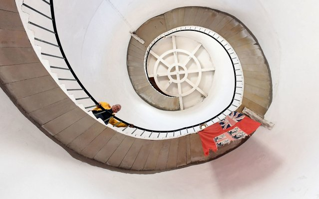 Stephen Burke, a volunteer at the Happisburgh Lighthouse, on its 96-step staircase in Norfolk, England. It welcomed visitors for the first open day of the year yesterday, April 21, 2019. (Photo by Joe Giddens/PA Wire Press Association)