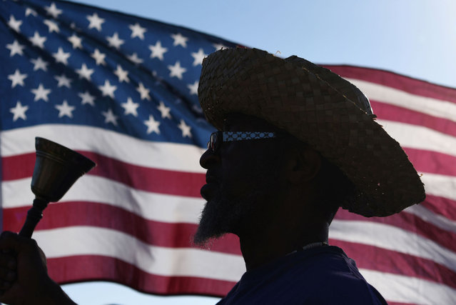 Brock Harrell, of Galveston, rings a bell during a reenactment to celebrate Juneteenth, which commemorates the end of slavery in Texas, two years after the 1863 Emancipation Proclamation freed slaves elsewhere in the United States, in Galveston, Texas, June 19, 2021. (Photo by Callaghan O'Hare/Reuters)