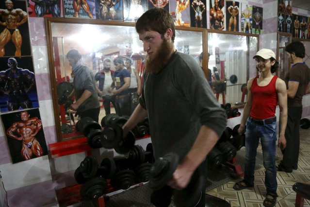 A man workouts in a gym, frequented by both residents and rebel fighters, in Aleppo's al-Fardous district May 18, 2015. (Photo by Hosam Katan/Reuters)