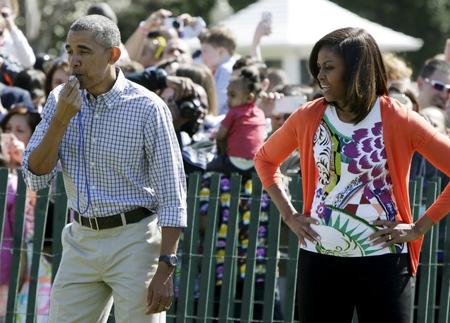 U.S. President Barack Obama and first lady Michelle Obama start the first race at the annual White House Easter Egg Roll in Washington April 6, 2015. (Photo by Gary Cameron/Reuters)