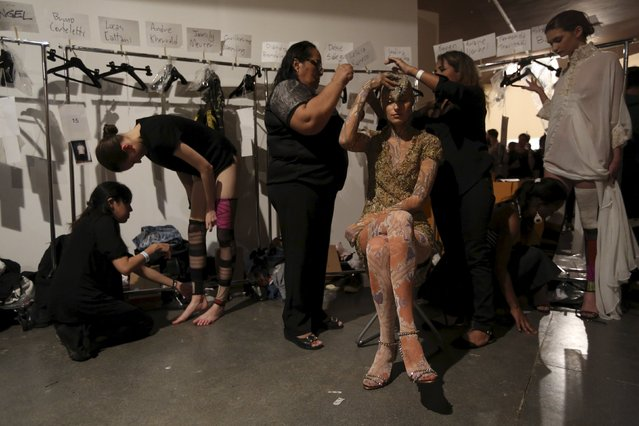 Models get ready backstage at Lino Villaventura Summer 2016 Ready To Wear collection during Sao Paulo Fashion Week in Sao Paulo April 16, 2015. (Photo by Paulo Whitaker/Reuters)
