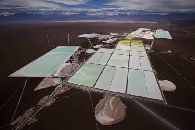 An aerial view of the brine pools and processing areas of the Rockwood lithium plant on the Atacama salt flat, the largest lithium deposit currently in production, in the Atacama desert of northern Chile, January 10, 2013. (Photo by Ivan Alvarado/Reuters)