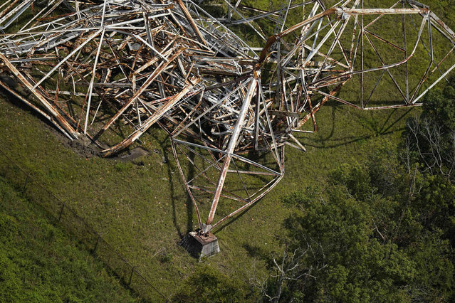 The rusted supports of a twisted tower, that carried crucial electrical feeder lines to the New Orleans metro area, is seen collapsed in the aftermath of Hurricane Ida in Bridge City, La., Wednesday, September 1, 2021. (Photo by Gerald Herbert/AP Photo)