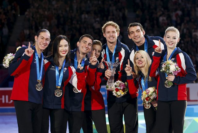 Figure skaters of the U.S team pose for pictures with their trophy and gold medals during a medal ceremony at the ISU World Team Trophy in Figure Skating in Tokyo April 18, 2015. (Photo by Yuya Shino/Reuters)