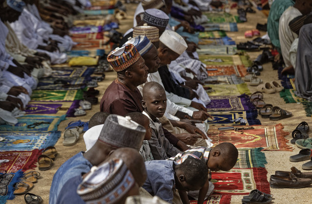 Muslims make traditional Friday prayers at a mosque near to the Emir's palace in Kano, northern Nigeria Friday, February 15, 2019. (Photo by Ben Curtis/AP Photo)