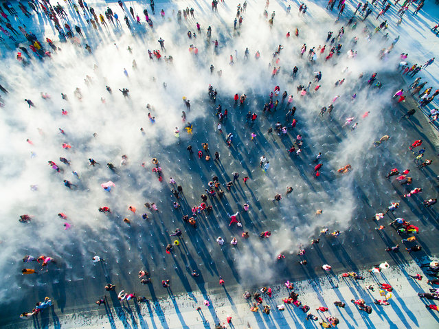 City cool. People play amid the fountains. (Photo by SkyPixel)