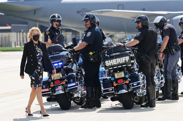 US First Lady Jill Biden walks near to the local motorcycle police escort before boarding a plane, in Milwaukee, Wisconsin on September 15, 2021. First Lady Jill Biden attended a listening session with educators and parents to discuss the return of in-person learning and the Covid-19 safety measures involved. (Photo by Evelyn Hockstein/Pool via AFP Photo)