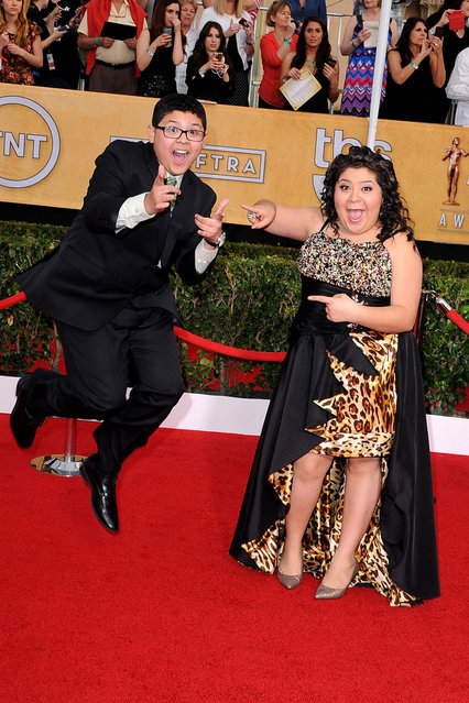 Actors Rico Rodriguez (L) and Raini Rodriguez attend the 20th Annual Screen Actors Guild Awards at The Shrine Auditorium on January 18, 2014 in Los Angeles, California. (Photo by Steve Granitz/WireImage)