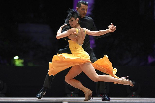Jesus Taborda and Sabrina Amuchastegui compete in the final round of the Tango World Championship stage category, in Buenos Aires, Argentina, Saturday, September 25, 2021. (Photo by Natacha Pisarenko/AP Photo)