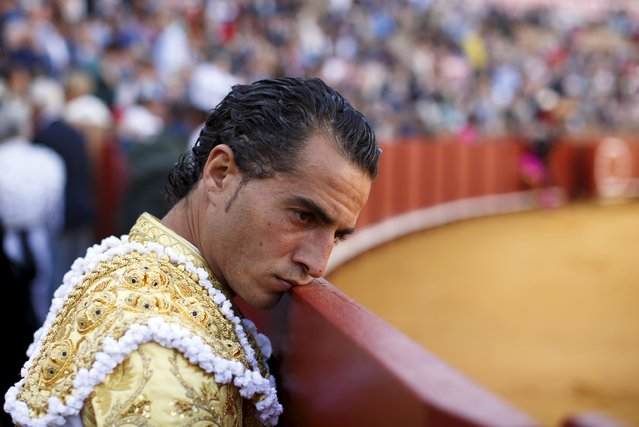 Spanish matador Ivan Fandino loans his face on the barrier during a bullfight at The Maestranza bullring in the Andalusian capital of Seville, southern Spain April 26, 2015. (Photo by Marcelo del Pozo/Reuters)