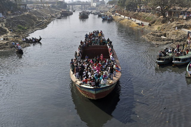 Hundreds of Bangladeshi Muslims board a ferry after attending three-day Islamic Congregation on the banks of the River Turag in Tongi, 20 kilometers (13 miles) north of the capital Dhaka, Bangladesh, Sunday, January 26, 2014. (Photo by A. M. Ahad/AP Photo)